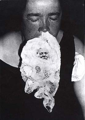 Ectoplasm photographed under seance in the 19th century. Note the small face.
